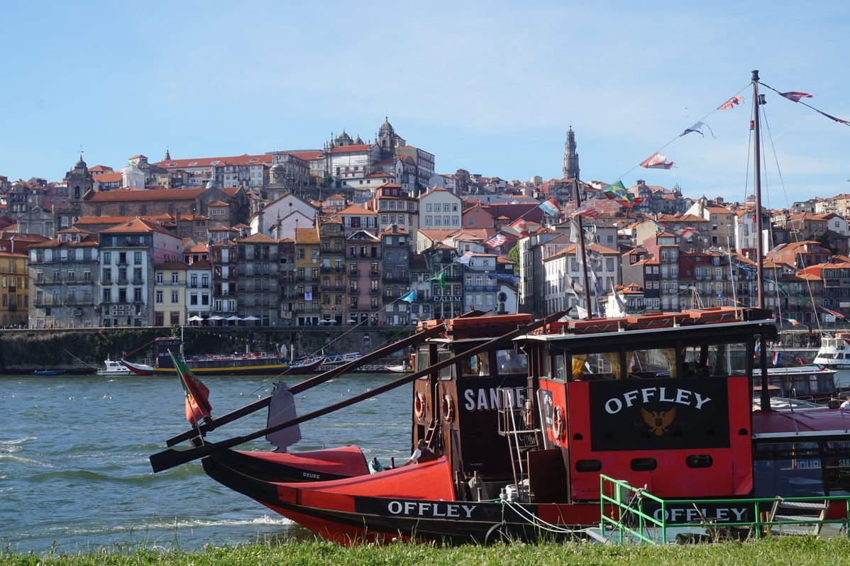 boats resting in the douro river in porto portugal